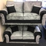 black and 2 seater silver crushed velvet sofa